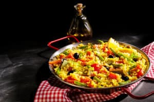 Colorful Vegetarian Spanish Paella Served with Oil