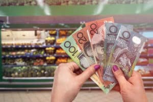 Australia fresh fruits and vegetables, hand with dollars