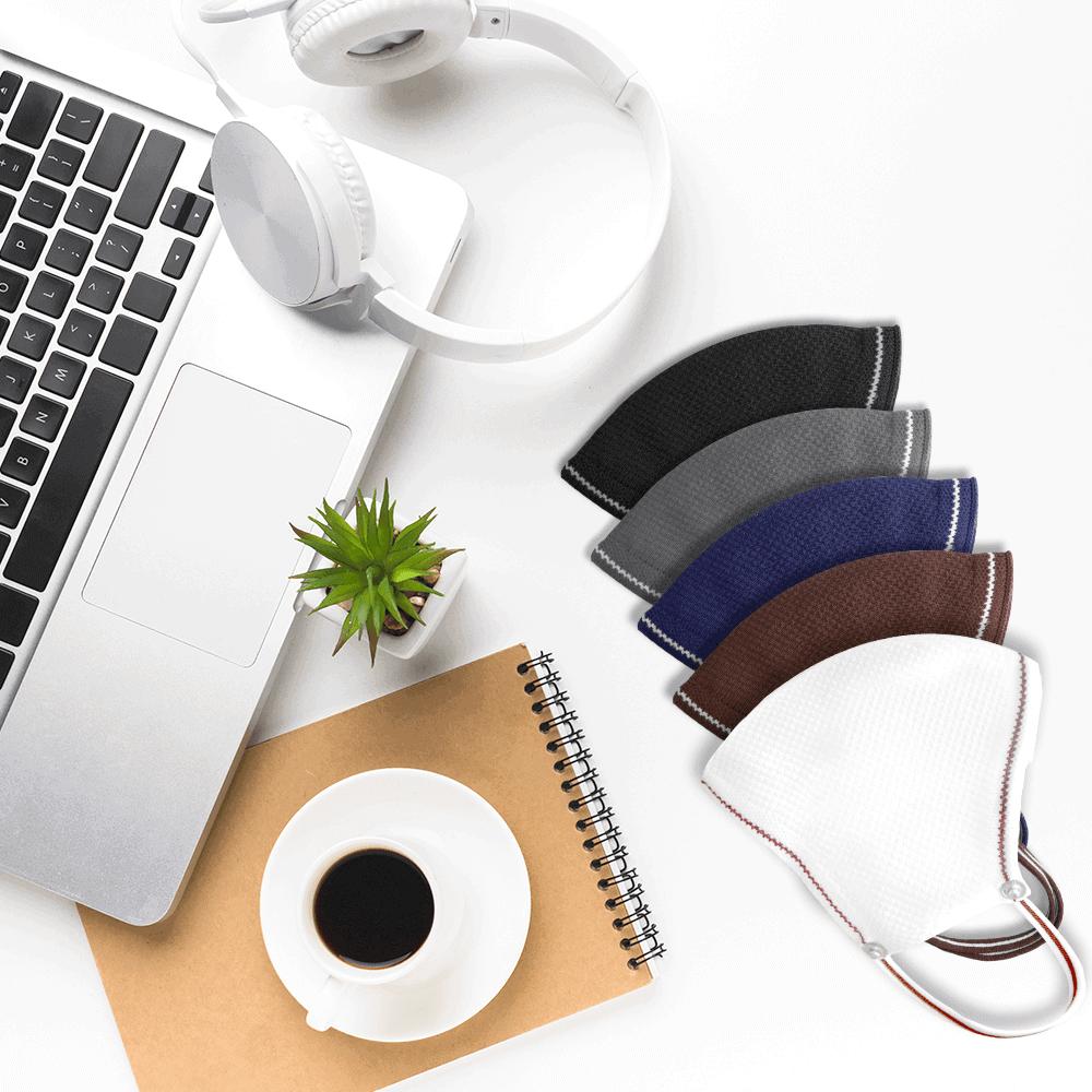 AirX coffee masks on desk, laptop